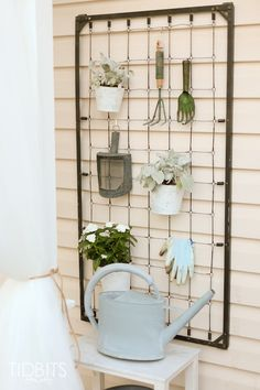 Craftberry Bush | Repurposed crib garden tool hanger | http://www.craftberrybush.com