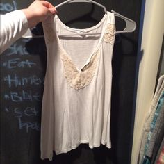 Tank top Creamy, flowy top with detailing near neckline. Gently worn no more than 5-7 times. Few straggling threads, but nothing noticeable. Aeropostale Tops Tank Tops