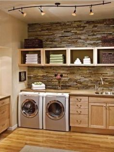 Beautiful laundry room leaves me wondering if I cant have just ONE messy room in the house? Why not the laundry room?) Laundry room - love the stone wall. Laundry Room Storage, Laundry Room Design, Laundry In Bathroom, Laundry Area, Basement Laundry, Small Laundry, Laundry Shelves, Bathroom Plumbing, Laundry Decor