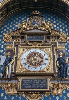 Ornate clock on a tower of the Concierge, Paris