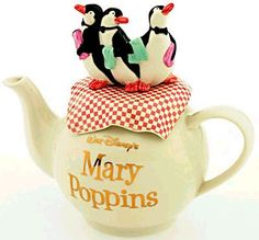 Walt Disney's Mary Poppins teapot ... penguin waiters standing on checked tablecloth as lid and knob, title written in gold, in same lettering as the film, on round cream body, c. 1960s, ceramic, USA