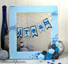 Denim flowers and chicken wire frame made out of an up-cycled a wood frame and old jeans,  {ribbonsandglue.com}