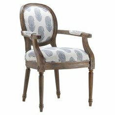 "A timeless addition to your dining room or master suite, this Louis-style arm chair showcases paisley-inspired upholstery and fluted detailing.   Product: ChairConstruction Material: Wood and fabricColor: Off-white, blue and walnutFeatures: Glaze finishDimensions: 38.25"" H x 24.5"" W x 22.75"" D"