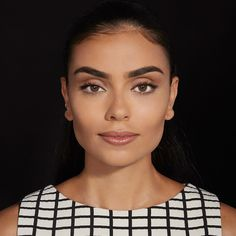 Learn how to cover and brighten dark circles under eyes with apricot, yellow & other color concealers in this color correcting makeup tutorial for medium skin.