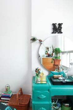 The teal Art Déco dressing table was found at a flea market 30 years ago and restored with chalk paint.
