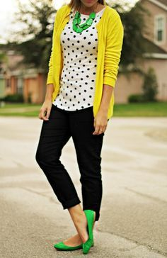 Yellow cardigan, black crop pants, black and white blouse, green flats and statement necklace