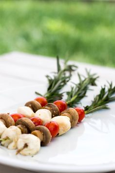 Healthy grilling recipes are great for the summer, and this rosemary caprese kabob on the grill is no exception! You'll combine mushrooms, tomatoes, and mozzarella on sprigs of rosemary to create a tasty, unique healthy appetizer. Vegetarian Mushroom Recipes, Best Mushroom Recipe, Caprese Salad Skewers, Caprese Salad Recipe, Mushroom Appetizers, Quick Appetizers, Mushroom Side Dishes, Skewer Recipes, Salad Recipes