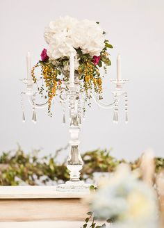 #hydrangea, #candelabra, #centerpiece  Photography: Studio Impressions Photography - studioimpressions.com.au Floral Design: Bloomz Bali - bloomzflowersbali.com/ Event Planning: M & M Innovative Concepts - mnm-concepts.com/  Read More: http://www.stylemepretty.com/2013/04/02/bali-wedding-from-studio-impressions-photography/