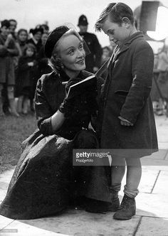 T,V, and Films, 19th November 1950, Farnborough, Hampshire, A picture of legendary German actress Marlene Dietrich (1901-1992) meeting a young boy who wants her autograph, Dietrich is filming her movie -No Highway+