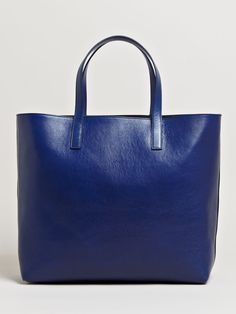Jil Sander- Womens Large Matteotti Bag- $1248  Coated leather large tote. Throw in all the on-board plane essentials for your flight.