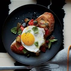 Ratatouille Toasts with Fried Eggs Recipe on Food & Wine - This is an ideal make-ahead brunch recipe; the luscious ratatouille tastes even better when made the day before. Breakfast And Brunch, Egg Recipes For Breakfast, Breakfast Ideas, Turkish Breakfast, Breakfast Skillet, Sunday Brunch, Ratatouille, Sandwiches, Fried Egg Recipes