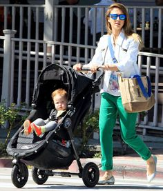Jessica Alba, wearing green pants, and daughter Haven are seen leaving Le Pain Quotidien in Los Angeles, California on March 30, 2013.