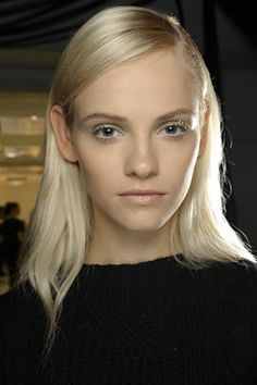 DEREK LAM - At the roots, hair was sleek and side-parted.