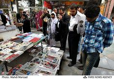 Iranians lining up to read the news.