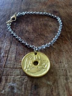 Excited to share the latest addition to my shop: Lucky coin Handmade Bracelets, Coins, Etsy Shop, Pendant Necklace, Trending Outfits, Unique Jewelry, Vintage
