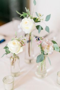 Simple floral centerpieces, jars with cream roses, wildflowers // Catherine Ann Photography
