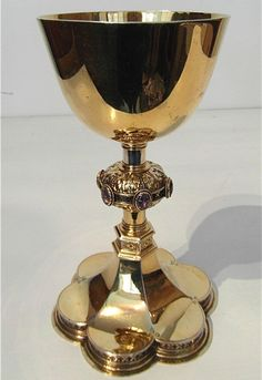 Gothic silver gilt chalice - manner of William Burgess    Gothic silver gilt chalice with semi precious stone cabochons and pierced and chased decoration in the manner of William Burgess  Stamped Krall Initialled CKH  Stamped 1893