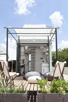 South African architect Clara da Cruz Almeida. 183-square-foot prefab house—Life Pod, manufactured in Johannesburg, arrives on site in a flatpack ready to be assembled. Designers Dokter and Misses created clever interior spaces—with a micro-kitchen, folding furniture, and an enviable amount of storage.