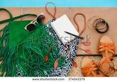 woman's accessories composed on floor, pool, still life, view from above, summer fashion trend, vintage boho style, vacation, notebook, sunglasses, sandals, dress, purse, pen, travel diary, bracelets