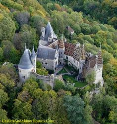 Château de la Rochepot,  La Rochepot, Côte d'Or département, Burgundy, France....    http://www.castlesandmanorhouses.com    ....     The Château de la Rochepot is a 13th-century castle, later converted into a château, located on the N6 to the south west of the town of Beaune. The castle was built on an outcrop of limestone to the north of the village of La Rochepot. As with many castles, it fell into ruin after the medieval period and was restored in the 19th century. It is open to…