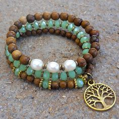Mala bracelet stack, green crystal, genuine freshwater pearls, wood and a tree of life charm