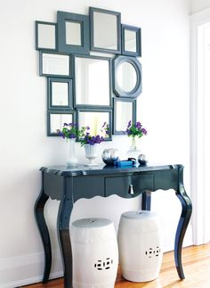 Love this! I have done something similar before! The trick is painting all the frames the same color so they read as one larger piece. I love this one even more as the frame color is matched to the hall table color. Perfection!