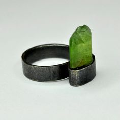 ring. Orough peridot & oxidized silver. alberto dávila. mexico.  Like cash sticking out of your pocket.