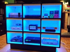 LED lit up console gaming shelves via mikeyfids on Instructables. Organized game systems in colorful light displays.