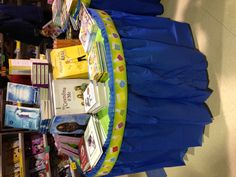 Border with tablecloths to decorate book fair tables. Cute!