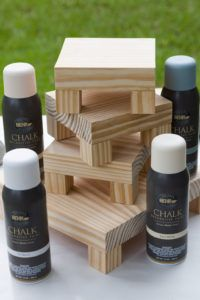 Spray chalk paint for my DIY display risers. These wood risers were made from scrap wood and took only minutes to make. Easy beginner woodworking project. Rustic Farmhouse style wood pedestal stands are perfect for vignettes, holiday decorating, craft show displays and more. Easy step by step directions. #rustichomedecor #kippiathome  #farmhousestyle #woodworkingprojects