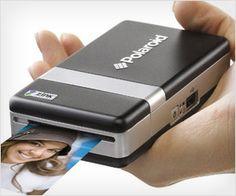 hand-held instant portable photo printer.