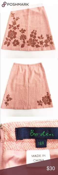 Boden tweed skirt Lovely pink tweed skirt featuring velvet floral appliqué. Hidden zipper closure. Excellent condition! Size 16 uk, so more like a 12 US. Flat measurements are waist: 16.5, hips: 21.5, and length: 25 inches. Boden Skirts