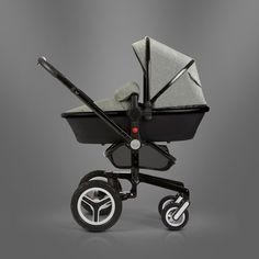 The Special Edition Surf 2 Eton Grey from Silver Cross, shown here in carrycot mode. The revolutionary Surf 2, with its light yet strong magnesium alloy chassis and air sprung suspension, offers outstanding multi-terrain handling.
