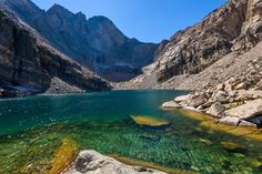 """Accessible by hike in Rocky Mountain National Park, Chasm Lake is known around Colorado for its stunning panoramic views and brilliant coloring. It's located at close to 12,000 feet, so this one tends to be a destination many people dream about seeing in person, but never reach.  NEARBY: Colorado's Pond in the Clouds!  The name """"Chasm Lake"""" comes directly from the definition of chasm, meaning a deep hole or gorge in a rock.  DISCOVER: What Makes Alpine Lakes So Blue?  The hike to get to…"""