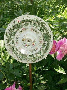 Flower Garden Yard Ornament Recycled Vintage Dishes   Saw these at a craft show recently. Very cute!