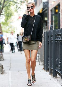 Flaunting a fringe top, an army green mini skirt and statement cat-eye sunnies, Nicky Hilton treated the sidewalk as her runway!