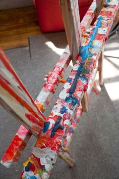 One of my many easels, thick with paint on it. They all kind of look like this. - Claire Desjardins.