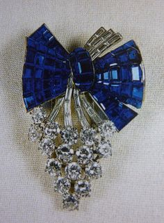 The Queen Mothers Diamond and Sapphire Bunch of Grapes brooch now worn by HM Queen Elizabeth.