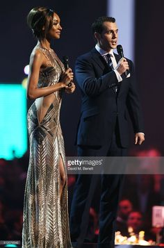 Jourdan Dunn (L) and Henry Cavill present an award at the BRIT Awards 2016 at The O2 Arena on February 24, 2016 in London, England.
