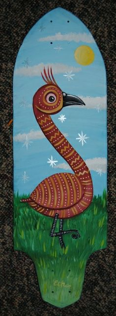 A painted skateboard featuring a pretty bird