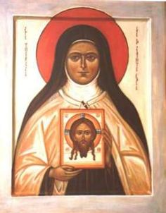 St. Therese of the Child Jesus (or, St. Therese of Lisieux holding the icon of The Holy Face.