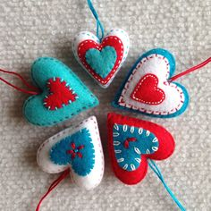 Felt heart ornaments in aqua red and white. Set of 5 by Lucismiles