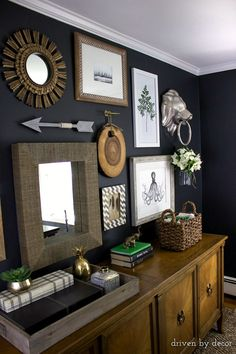 Home office gallery wall on charcoal walls