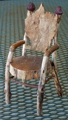 Driftwood armchair with bark back by George C. Clark.