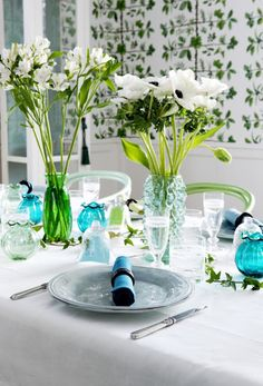 Vases coordinating with the color you choose, yellow or blue, green or even a pink or purple, anything goes with green.