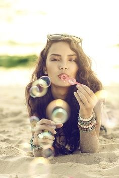 Beach shoot, cute idea with the bubbles.  Age appropriate.