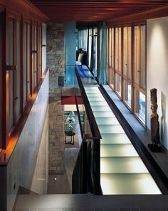 unique idea: translucent glass flooring with lights inside for hallway or access to upper level