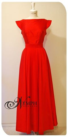 """""""The Red Wedding Guest"""". Very simple red silk dress made with a full length circle skirt, pleated belt and a simple boat-neck neckline."""