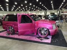 Pink Lexus SUV... I think...FK it just look at the shape of those rims and the rims are pink toooooo! Awwwwwwwwsoooommmeness!