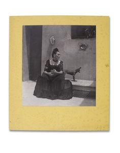 Frida Kahlo, circa 1944, by Lola Alvarez Bravo. A portrait of the artist at the Casa Azul alongside one of her xoloescuintle dogs, the rare, hairless breed tied to the Aztec culture. The portrait shows off the Blue House, as it was also known, which was built by her father the year she was born, 1907. When Diego Rivera paid up the mortgage after the two married, the couple remade the French neoclassical design into more of a stucco look, filling it with Mexican artifacts and figurines.